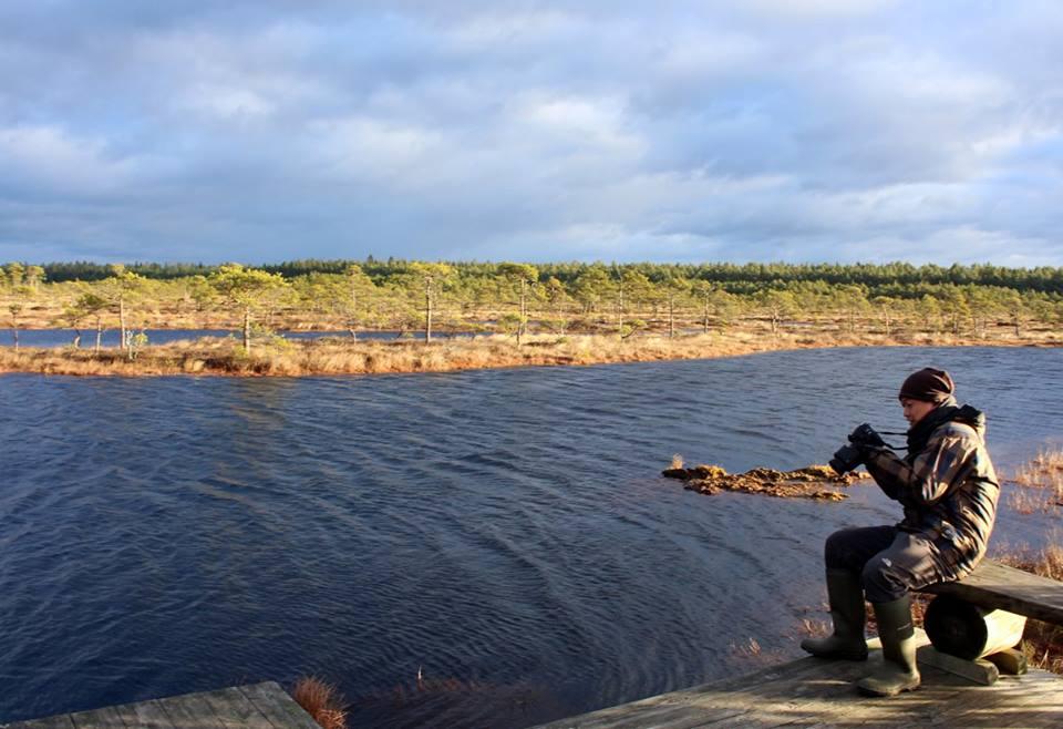 photographer by bog pool