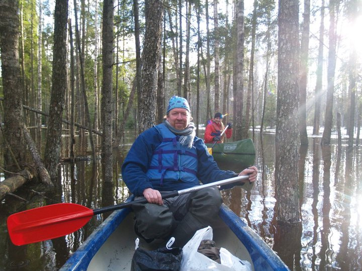 Canoeing in flooded forest